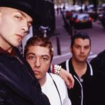 banda Rancid em foto de divulgação do álbum ...And Out Comes the Wolves de 1995